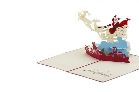 Geschenkkarte - Kirigami Weihnachtsmann auf der Stadt