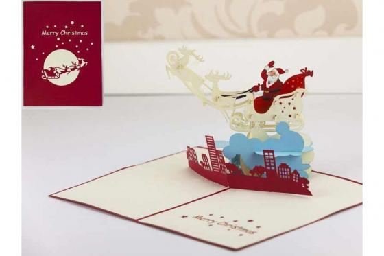 Geschenkkarte - Kirigami Weihnachtsmann auf der Stadt        1